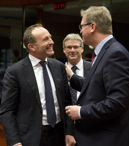 Danish Foreign Minister Martin Lidegaard, left, speaks with European Commissioner for Enlargement Stefan Fule during a meeting of EU foreign ministers in Brussels on Monday, Feb. 10, 2014. EU foreign ministers on Monday will discuss how to help foster a political situation for the severe crisis that has engulfed Ukraine. The 28 ministers were also weighing the fallout of Sunday's referendum in Switzerland putting into question the free movement of citizens between the bloc and the Alpine nation. (AP Photo/Virginia Mayo)