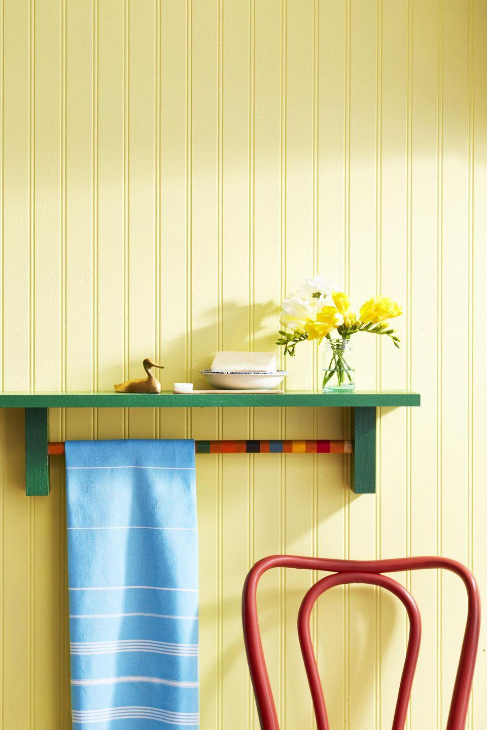 <p>A bathroom get an instant upgrade with the addition of this bright and cherry towel rack. Paint the wood any color desired.<strong><br></strong></p><p><strong>To make:</strong> Cut a 1-by-5-inch piece of wood 27 inches long. Cut a piece of 2 1/2-by-1 1/4 wood into two 5 1/2-inch-long segments; drill a 1-inch hole 1 inch deep in centers of each. Cut mallet handle 20 inches long, and fit in holes; glue in place. Glue blocks to top shelf. Paint desired color.</p>