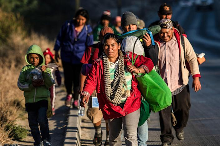 <p>TOPSHOT – Central American migrants, taking part in a caravan towards the US, arrive to Tijuana, Mexico, on Nov. 15, 2018. (Photo: Guillermo Arias/AFP/Getty Images) </p>