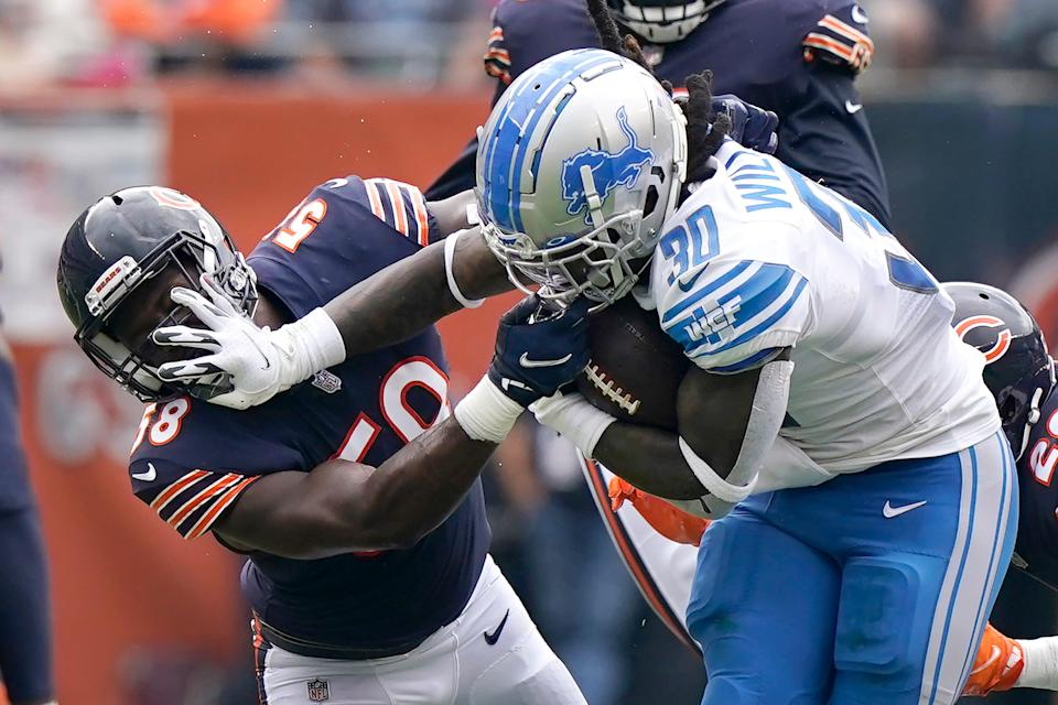 Detroit Lions running back Jamaal Williams stiff arms Chicago Bears inside linebacker Roquan Smith during the first half Sunday, Oct. 3, 2021, in Chicago.