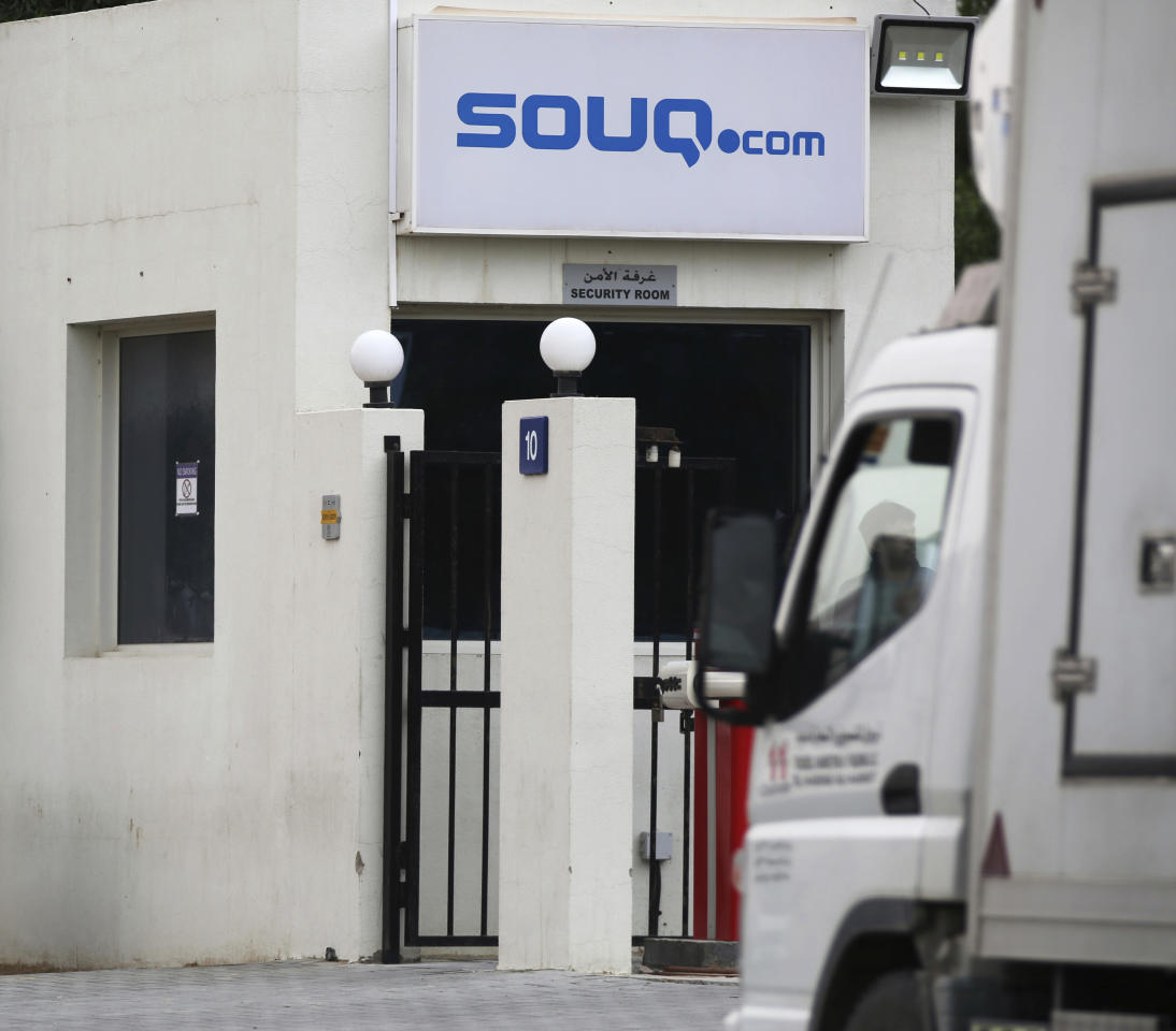 <p> A truck is parked at the entrance of the Souq.com warehouse in Dubai, United Arab Emirates, Monday, March 27, 2017. Dubai's Emaar Malls, a subsidiary of the state-backed construction firm Emaar, said Monday it made an $880-million offer to buy the online retailer Souq.com amid rumors of a possible acquisition of the firm by Amazon. (AP Photo/Jon Gambrell) </p>