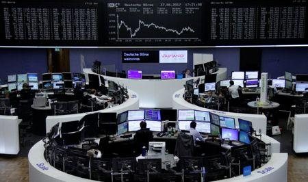Traders work in front of the German share price index, DAX board, at the stock exchange in Frankfurt, Germany, June 27, 2017. REUTERS/Staff/Remote
