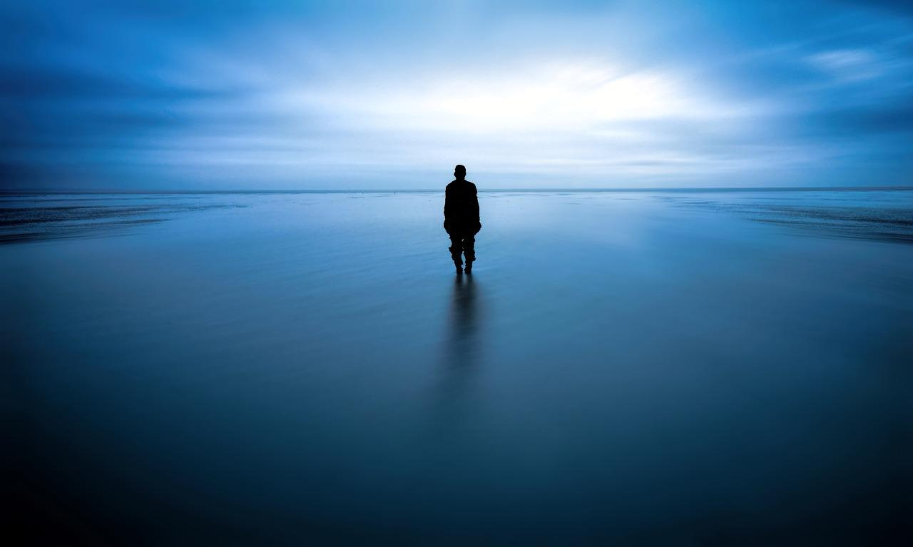 <p>This image of a lone man standing knee-deep in the blue waters on Crosby Beach, Liverpool, won the 'People and the Sea' category. (Image: Rev Dr Richard Hainsworth)<br /></p>