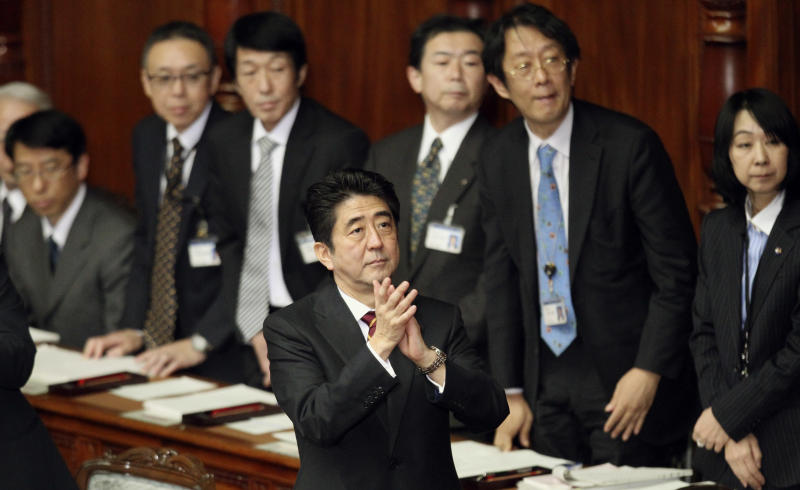 Japan's Prime Minister Shinzo Abe, center, acknowledges foreign delegations who are attending a plenary session at the lower house of parliament in Tokyo, Thursday, Feb. 28, 2013. Abe vowed to push ahead with more aggressive monetary easing with the nomination Thursday of Asian Development Bank President Haruhiko Kuroda to head Japan's central bank. (AP Photo/Junji Kurokawa)
