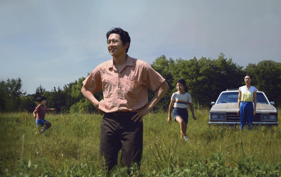"""This image released by A24 shows Steven Yeun, foreground, in a scene from """"Minari,"""" named one of the top 10 films of the year by The American Film Institute. (David Bornfriend/A24 via AP)"""