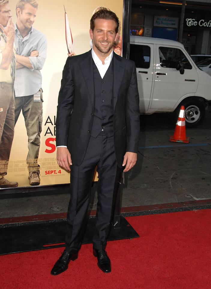 "Bradley Cooper stepped out in his trademark scuff and a dapper, navy three-piece suit for the LA premiere of his new romantic comedy, ""All About Steve."" It's easy to see why all of Hollywood is crushing on the actor! Steve Granitz/<a href=""http://www.wireimage.com"" target=""new"">WireImage.com</a> - August 26, 2009"