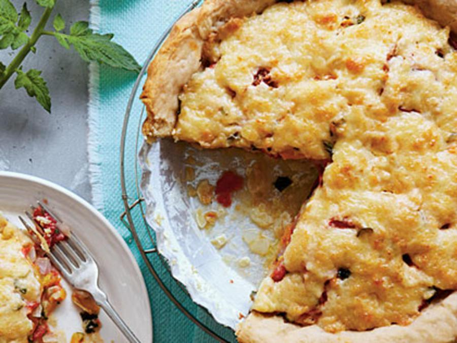 """<p>Nothing says """"summer""""—or shows off summertime's best produce—like a classic tomato pie. Old-fashioned Tomato Pie is summer perfection thanks to garden <a href=""""https://www.myrecipes.com/ingredients/fresh-tomato-recipes"""" rel=""""nofollow noopener"""" target=""""_blank"""" data-ylk=""""slk:fresh tomatoes"""" class=""""link rapid-noclick-resp"""">fresh tomatoes</a> and chopped herbs such as <a href=""""https://www.myrecipes.com/how-to/7-ways-with/recipes-using-fresh-basil"""" rel=""""nofollow noopener"""" target=""""_blank"""" data-ylk=""""slk:basil"""" class=""""link rapid-noclick-resp"""">basil</a>, thyme, parsley, or chives. When you serve Old-fashioned Tomato Pie, this plate of goodness is always a home run.</p>"""