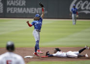Atlanta Braves' Ozzie Albies, right, steals second base beneath Toronto Blue Jays' Bo Bichette in the first inning of a baseball game Thursday, May 13, 2021, in Atlanta. (AP Photo/Ben Margot)