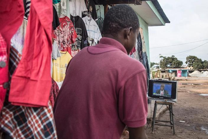 A man watches a televised political debate in Port-Gentil ahead of presidential elections in Gabon (AFP Photo/Samir Tounsi)