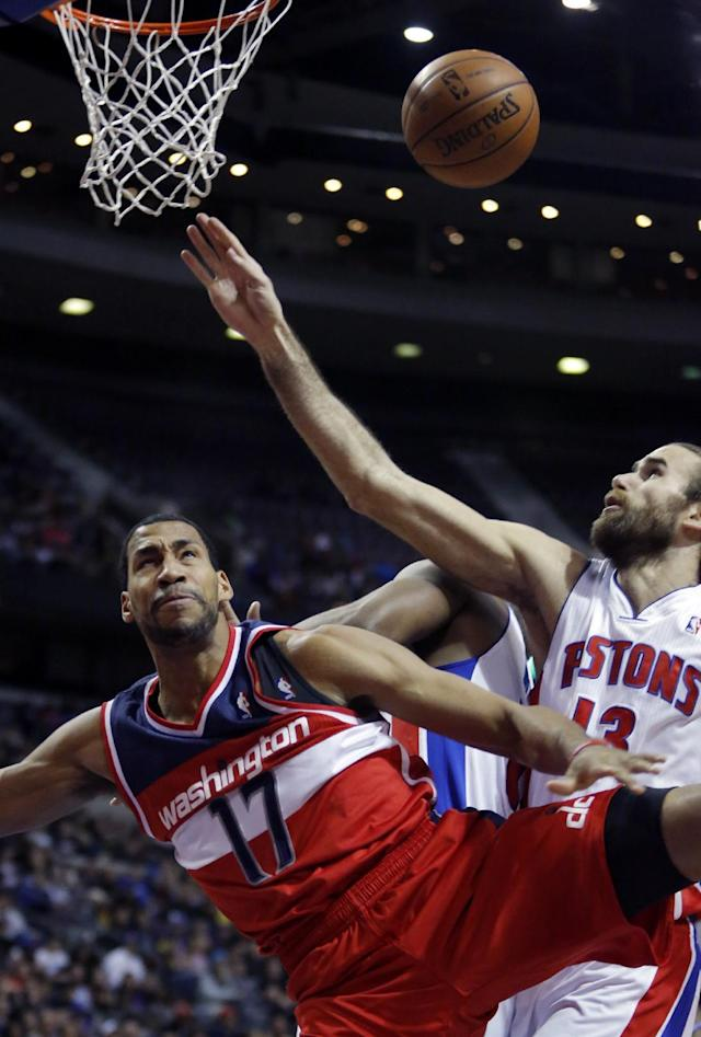 Washington Wizards guard Garrett Temple (17) looses the ball after being fouled by Detroit Pistons forward Luigi Datome while going to the basket during the first half of an NBA basketball game, Monday, Dec. 30, 2013, in Auburn Hills, Mich. (AP Photo/Duane Burleson)