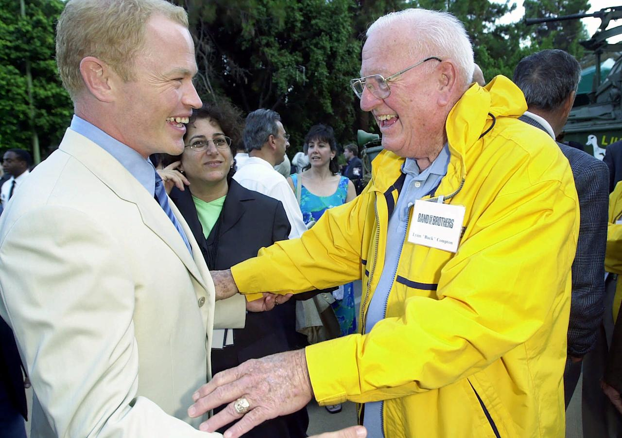"Veteran Lynn Compton, right, greets actor Neal McDonough, who portrays him in HBO's 10-part miniseries ""Band of Brothers,"" at a screening of portions of the miniseries at the Hollywood Bowl, Wednesday, Aug. 29, 2001, in Los Angeles. The miniseries tells the story of Easy Company, the 506th Regiment of the Army's 101st Airborne Division. Its missions ranged from parachuting behind enemy lines on D-Day to capturing Hitler's mountain chalet in southern Germany. (AP Photo/Kevork Djansezian)"