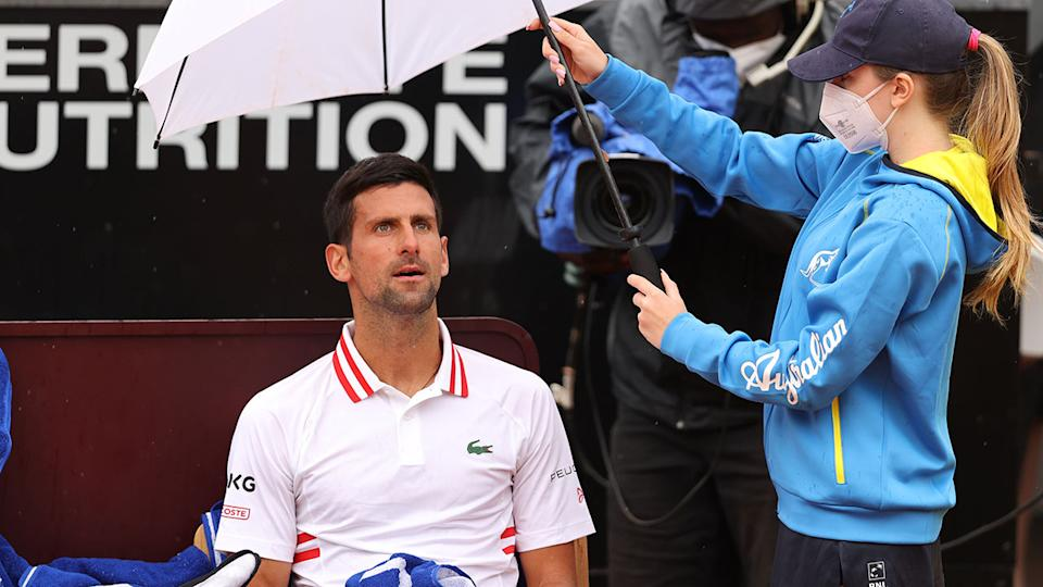 Novak Djokovic, pictured here sheltering under an umbrella at the Italian Open.