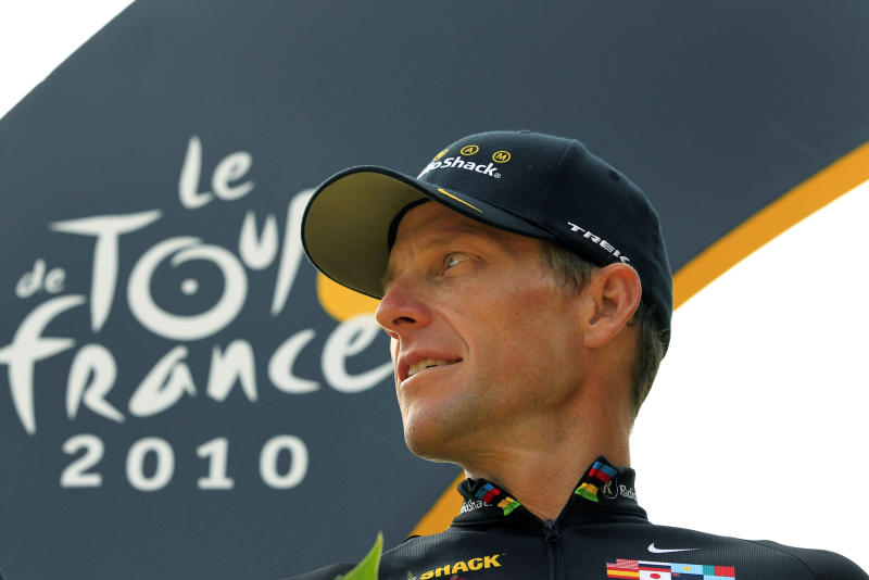 FILE - In this July 25, 2010, file photo, Lance Armstrong looks back on the podium after the 20th and last stage of the Tour de France cycling race in Paris, France. Armstrong confessed to using performance-enhancing drugs to win the Tour de France during a taped interview with Oprah Winfrey that aired Thursday, Jan. 17, 2013, reversing more than a decade of denial. (AP Photo/Bas Czerwinski, File)