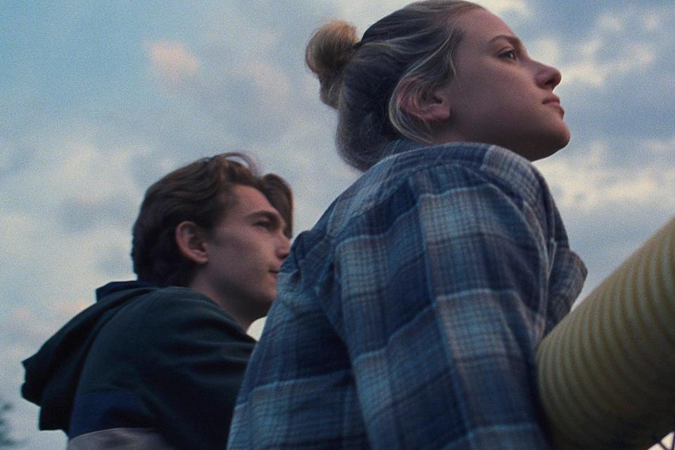 """<p>Grace (Lili Reinhart) is new in town and somehow finds herself as the newly appointed co-editor-in-chief of her high school newspaper alongside Henry, a fellow student and hopeless romantic. There are a lot of reasons why Grace refuses to take her job as a writer seriously, and Henry is determined to get to the bottom of each and every one of them. Who knows, maybe they'll even fall in love along the way. </p> <p><a href=""""http://www.amazon.com/Chemical-Hearts-Lili-Reinhart/dp/B08DL6P44L"""" class=""""link rapid-noclick-resp"""" rel=""""nofollow noopener"""" target=""""_blank"""" data-ylk=""""slk:Watch Chemical Hearts on Amazon Prime."""">Watch <strong>Chemical Hearts</strong> on Amazon Prime.</a></p>"""