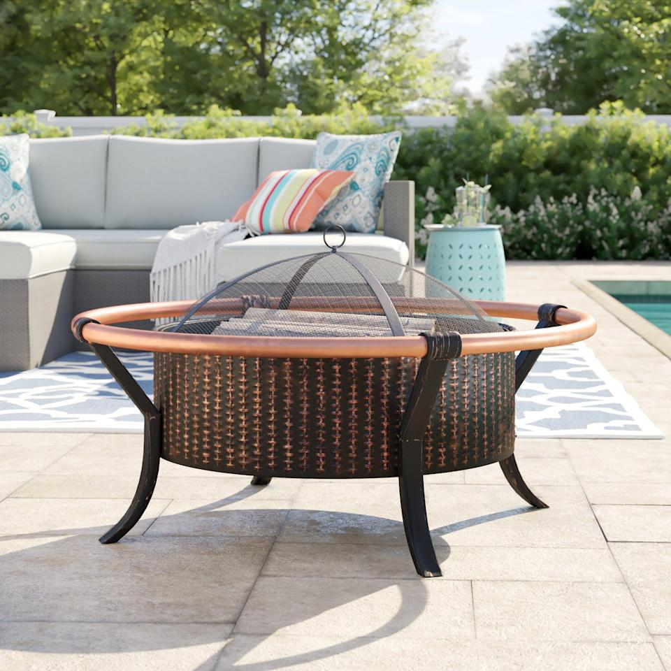 <p>This <span>Amalfi Rail Steel Wood Burning Fire Pit</span> ($148) will make the backyard your favorite spot to be.</p>