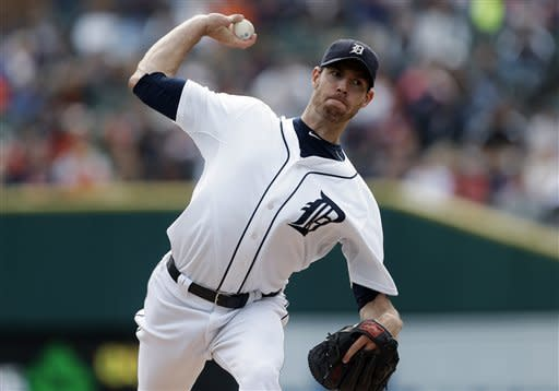 Detroit Tigers starting pitcher Doug Fister throws against the Kansas City Royals in the first inning of a baseball game in Detroit, Thursday, Sept. 27, 2012. (AP Photo/Paul Sancya)