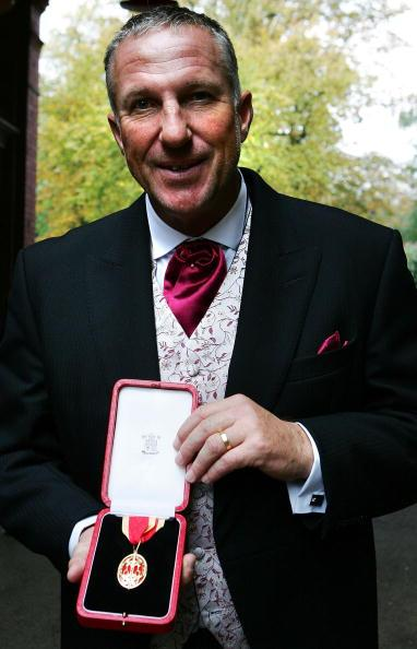 LONDON - OCTOBER 10:  Sir Ian Botham poses for a photograph as he arrives at Lord's Cricket Ground Pavilion for lunch on October 10, 2007 in London, England. The former England cricket captain is celebrating after he received a knighthood from the Queen at Buckingham Palace.  (Photo by Cate Gillon/Getty Images)