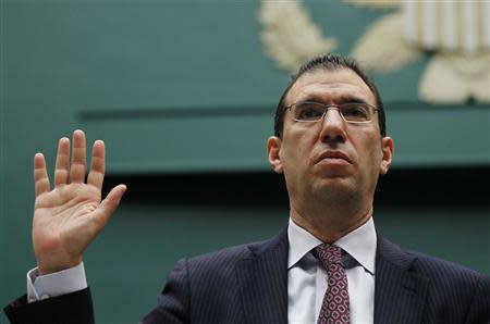 Andrew Slavitt, Executive Vice President for Optum/QSSI is sworn-in to testify at a House Energy and Commerce Committee hearing on the Patient Protection and Affordable Care Act on Capitol Hill in Washington, October 24, 2013. REUTERS/Jason Reed