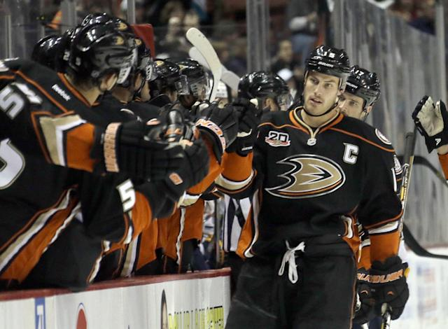 Anaheim Ducks center Ryan Getzlaf, right, is congratulated by teammates after his first of three goals in the first period against Buffalo Sabres in an NHL hockey game in Anaheim, Calif., Friday, Nov. 8, 2013. (AP Photo/Reed Saxon)