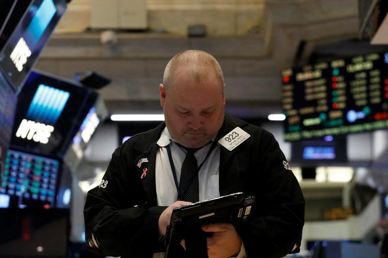 A trader works on the floor of the NYSE