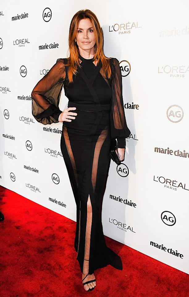 <p><b>When: Jan. 10, 2017</b> <br /> The 50-year-old former supermodel looked amazingly youthful in a sheer black formfitting Balmain gown at Marie Claire's Image Makers Awards. The sexy dress is from the Balmain resort 2017 collection and allowed Cindy to show some skin through its sheer balloon sleeves and mesh skirt inserts. <i>(Photo: Getty)</i> </p>