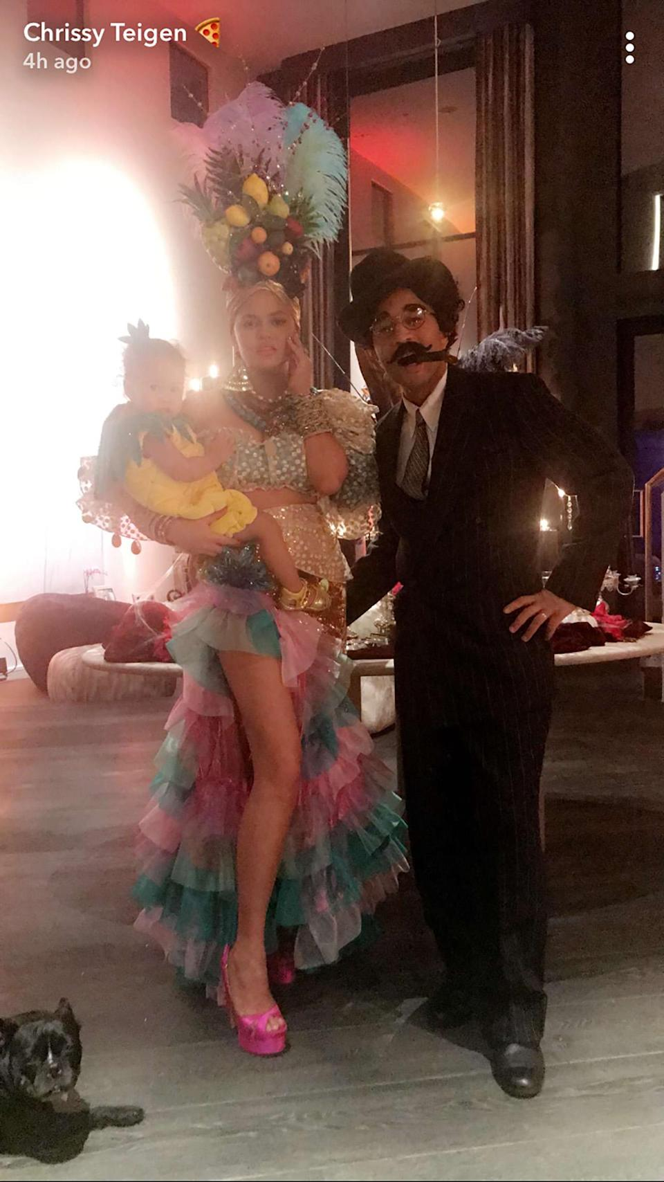<p>How do you like that pineapple? The model was Carmen Miranda, so it only made sense that her mini-me, Luna, was something fruity. As for John Legend, he was Miranda's <i>Copacabana </i>co-star Groucho Marx — stache and all. (Photo: Chrissy Teigen via Snapchat) </p>