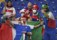 Fans take selfies with their phone before the Euro 2020 soccer championship group A match between Turkey and Italy at the Olympic stadium in Rome, Friday, June 11, 2021. (Ettore Ferrari/Pool via AP)