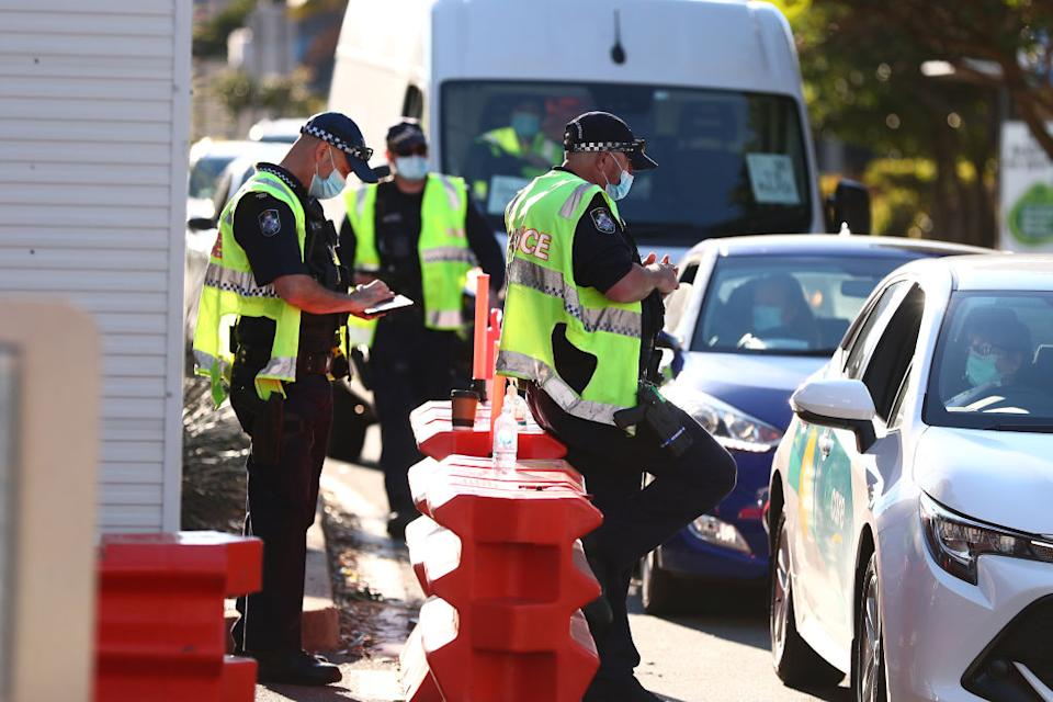 Queensland Police stop cars in Griffith street Coolangatta at the Queensland border in Coolangatta, Australia.