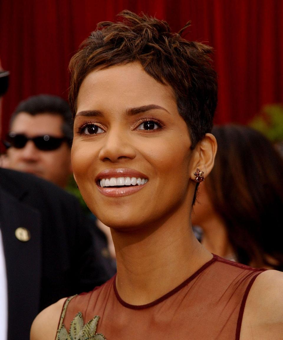 """<p><strong>Halle Berry, 2002</strong></p><p>In the annal of perfect pixies, Berry's remains a standout, thanks to piece-y styling and subtle highlights that picked up the golden and burgundy hues of her gown.</p><span class=""""copyright"""">Photo: KMazur/WireImage.</span>"""