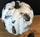 "<p>Here's another cool example of a decoupaged pumpkin. Begin by painting your pumpkin white with a fast-drying acrylic paint and then Mod Podge paper cutouts of different bugs. Try varying the scale of the bugs for a more realistic look. <i>(Photo: <a href=""http://confessionsofaplateaddict.blogspot.com/2013/10/whats-black-and-white-and-buggy-all.html"" rel=""nofollow noopener"" target=""_blank"" data-ylk=""slk:confessionsofaplateaddict"" class=""link rapid-noclick-resp"">confessionsofaplateaddict</a>)</i></p>"