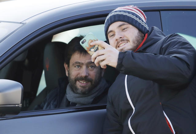 A supporter takes a picture with Juventus' president Andrea Agnelli as he arrives for a training session at the Continassa Juventus center, in Turin, Italy, Friday, Jan. 11, 2019. Las Vegas police say investigators are asking Italian authorities to obtain a DNA sample from Cristiano Ronaldo in an ongoing rape investigation. (AP Photo/Luca Bruno)