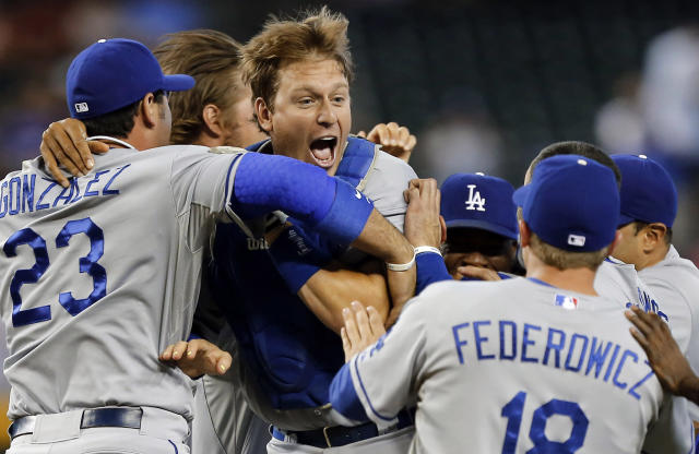 The Los Angeles Dodgers celebrate a 7-6 win over the Arizona Diamondbacks in a baseball game on Thursday, Sept. 19, 2013, in Phoenix. The Dodgers clinched the National League West title. (AP Photo/Matt York)