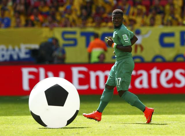 Ivory Coast's Serge Aurier runs towards the big ball during the 2014 World Cup Group C soccer match between Colombia and Ivory Coast at the Brasilia national stadium in Brasilia June 19, 2014. REUTERS/Eddie Keogh (BRAZIL - Tags: TPX IMAGES OF THE DAY SOCCER SPORT WORLD CUP)