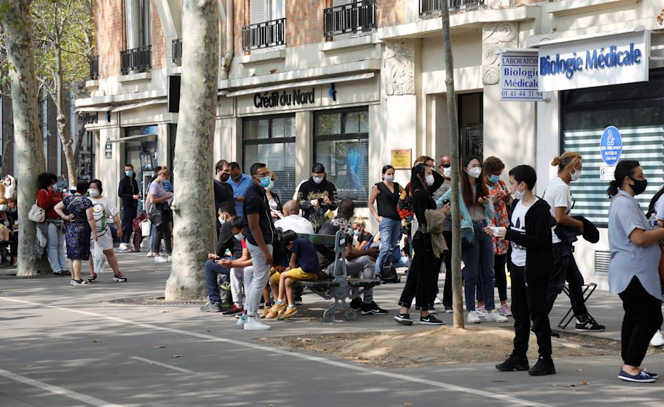People wait in line at a testing site for COVID-19 in Paris on Sept. 11.Lab workers in France say they have become overwhelmed. (Photo: Charles Platiau / reuters)