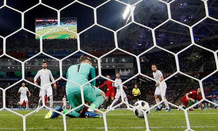 FILE PHOTO: Fisht Stadium, Sochi, Russia - June 15, 2018 Portugal's Cristiano Ronaldo scores their second goal past Spain's David De Gea REUTERS/Murad Sezer/File Photo
