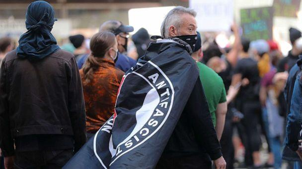 PHOTO: Hundreds of protesters gather at Government Center including a protester with an ANTIFA flag draped over his shoulders during a rally in Boston on May 31, 2020. (Matthew J. Lee/The Boston Globe via Getty Images)