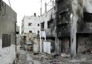 A building still shows the scorch marks from an arson attack during clashes in the camp