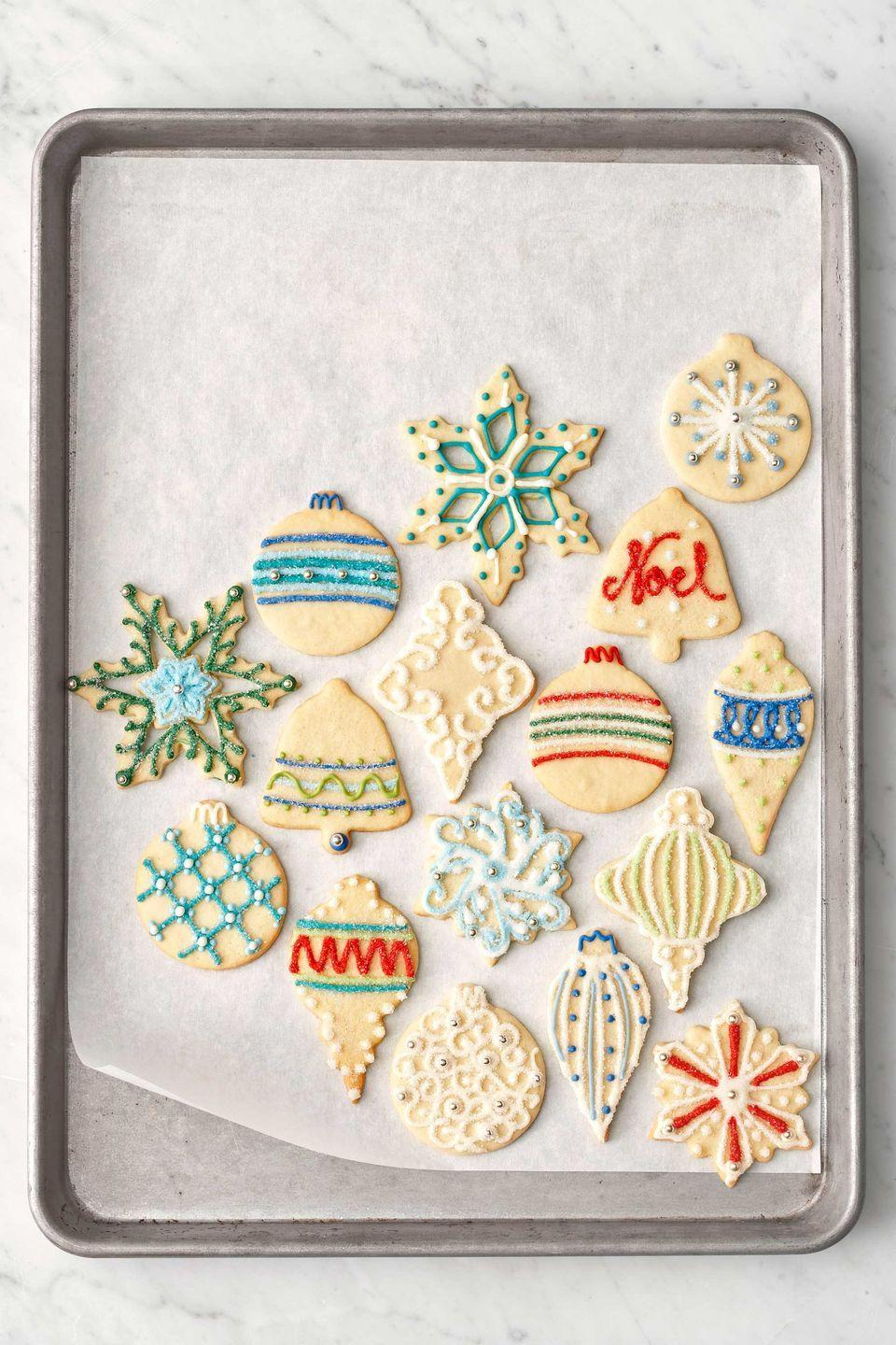 """<p>Simple sugar cookies go glamorous, thanks to ornament-shaped cutters and colorful icing.</p><p><strong><a href=""""https://www.countryliving.com/food-drinks/recipes/a3270/sugar-cookies-recipe/"""" rel=""""nofollow noopener"""" target=""""_blank"""" data-ylk=""""slk:Get the recipe"""" class=""""link rapid-noclick-resp"""">Get the recipe</a>.</strong></p>"""