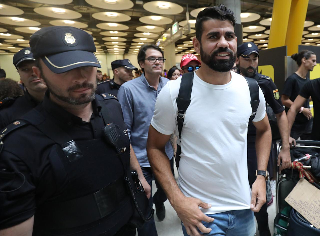 Spain's soccer player Diego Costa reacts upon arriving at Adolfo Suarez Madrid Barajas airport in Madrid, Spain, September 22, 2017. REUTERS/Sergio Perez