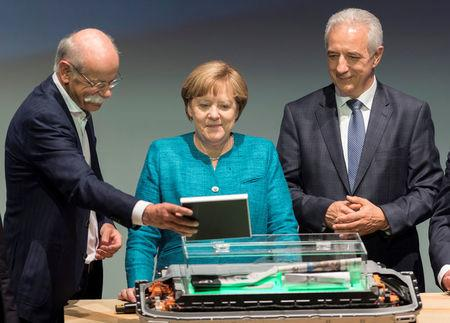FILE PHOTO: German Chancellor Merkel takes part in a ceremony for the opening of the second battery factory at Daimler subsidiary ACCUMOTIVE in Kamenz