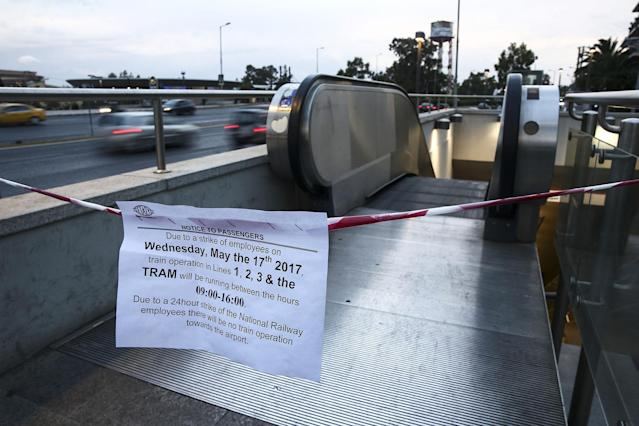 <p>Signs informing passengers about work stoppages hang from a cordon at a metro station in Athens, Greece, on Wednesday, May 17, 2017. Greeces economy returned to recession in the first quarter as delays in concluding talks between the government and its creditors raised the specter of another debt drama. (Yorgos Karahalis/Bloomberg via Getty Images) </p>