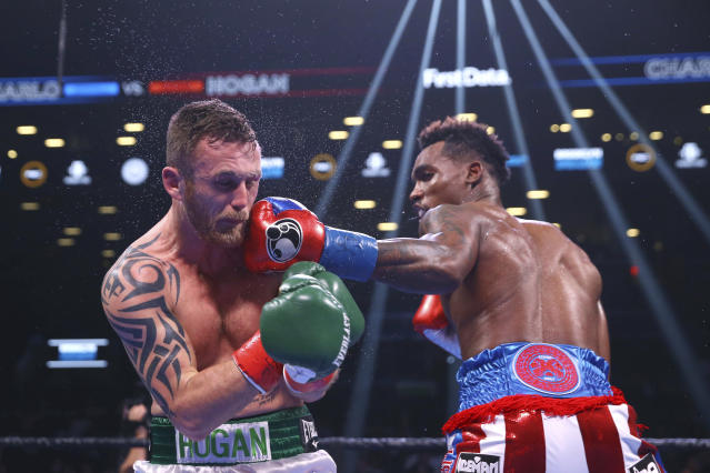 Jermall Charlo punches Ireland's Dennis Hogan during the fifth round of a WBC middleweight title boxing match Saturday, Dec. 7, 2019, in New York. (AP Photo/Michael Owens)