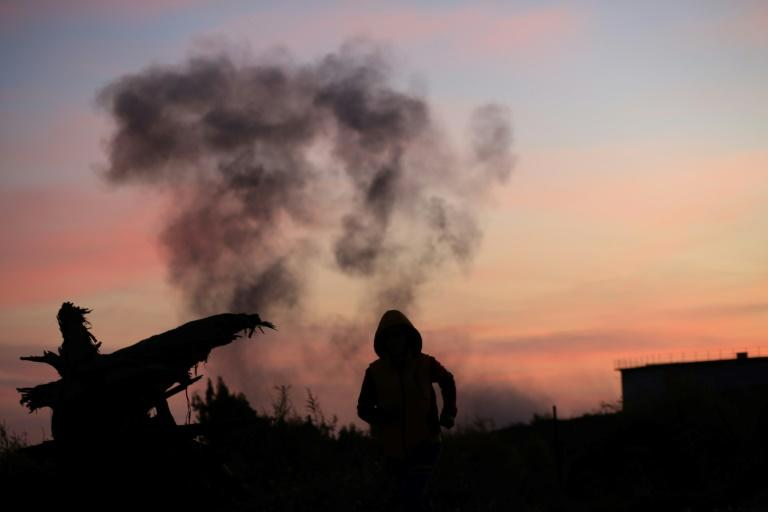 Smoke billows in Gaza City on November 30, 2017, after Israeli military strikes in Gaza in retaliation to mortar rounds fired from the Palestinian enclave