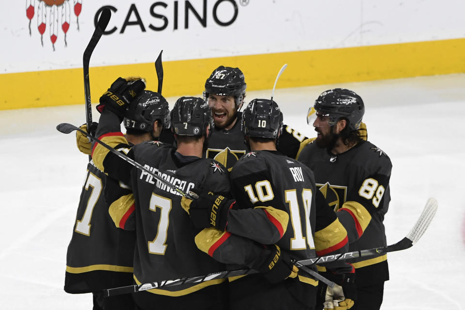 Vegas Golden Knights left wing Max Pacioretty (67) celebrates his goal with teammates during the third period in Game 5 of an NHL hockey Stanley Cup semifinal playoff series against the Montreal Canadiens Tuesday, June 22, 2021, in Las Vegas. (AP Photo/David Becker)