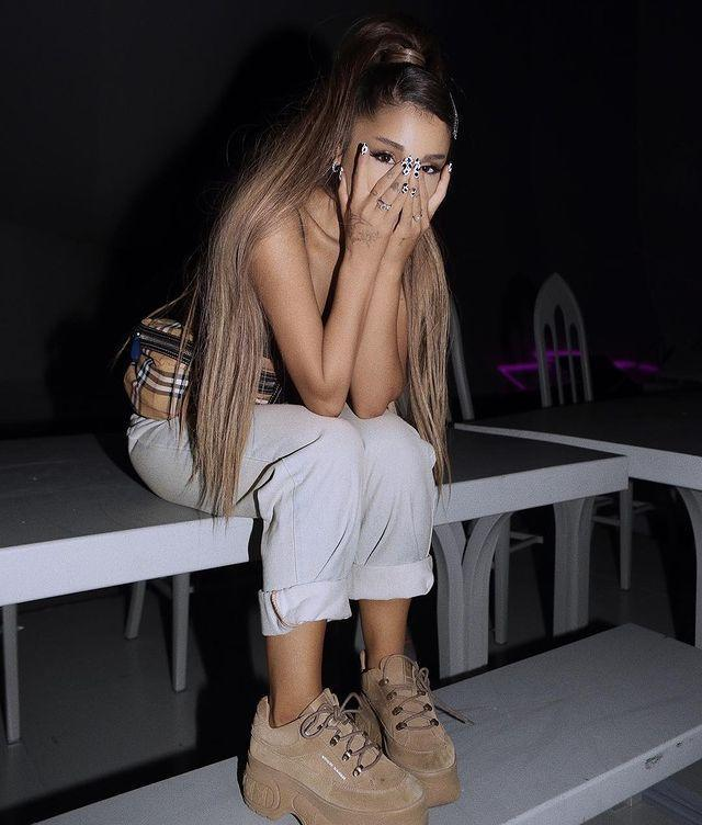 """<p>Making a rare departure from her hypebae aesthetic, Ariana is rocking spring's hottest western-inspired mani trend: cow print. If you look closely, she's got little black spots all over her pure white nails. <a href=""""https://www.instagram.com/p/Bvmta9UDe2_/"""" rel=""""nofollow noopener"""" target=""""_blank"""" data-ylk=""""slk:Kendall Jenner just rocked the same mani"""" class=""""link rapid-noclick-resp"""">Kendall Jenner just rocked the same mani</a>, FYI. </p><p><a href=""""https://www.instagram.com/p/BvrxMlhh_BI/?utm_source=ig_embed&utm_medium=loading"""" rel=""""nofollow noopener"""" target=""""_blank"""" data-ylk=""""slk:See the original post on Instagram"""" class=""""link rapid-noclick-resp"""">See the original post on Instagram</a></p>"""