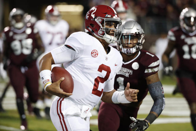 Alabama quarterback Jalen Hurts (2) sprints past Mississippi State defensive back Brandon Bryant (1) for a short touchdown run during the first half of an NCAA college football game in Starkville, Miss., Saturday, Nov. 11, 2017. (AP Photo/Rogelio V. Solis)