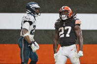 Cleveland Browns running back Kareem Hunt (27) celebrates after a 5-yard rushing touchdown during the second half of an NFL football game against the Philadelphia Eagles, Sunday, Nov. 22, 2020, in Cleveland. (AP Photo/Ron Schwane)