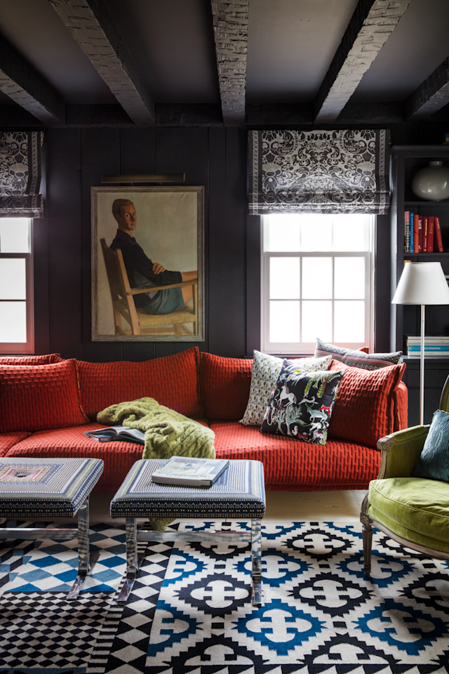 """<p>Walls and ceiling in Benjamin Moore's Nightfall—an almost-black shade of charcoal—provide a moody backdrop for the russet red sofa in <a href=""""https://www.housebeautiful.com/design-inspiration/house-tours/a25417770/designer-andrew-flesher-white-plains-home-tour/"""" target=""""_blank"""">Andrew Flesher</a>'s 300-year-old Westchester colonial.</p>"""