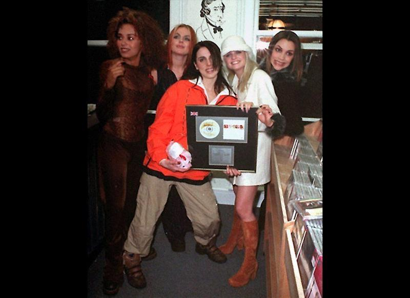 <strong>1996</strong> The Spice Girls show off their latest award during a visit to a record store in Birmingham
