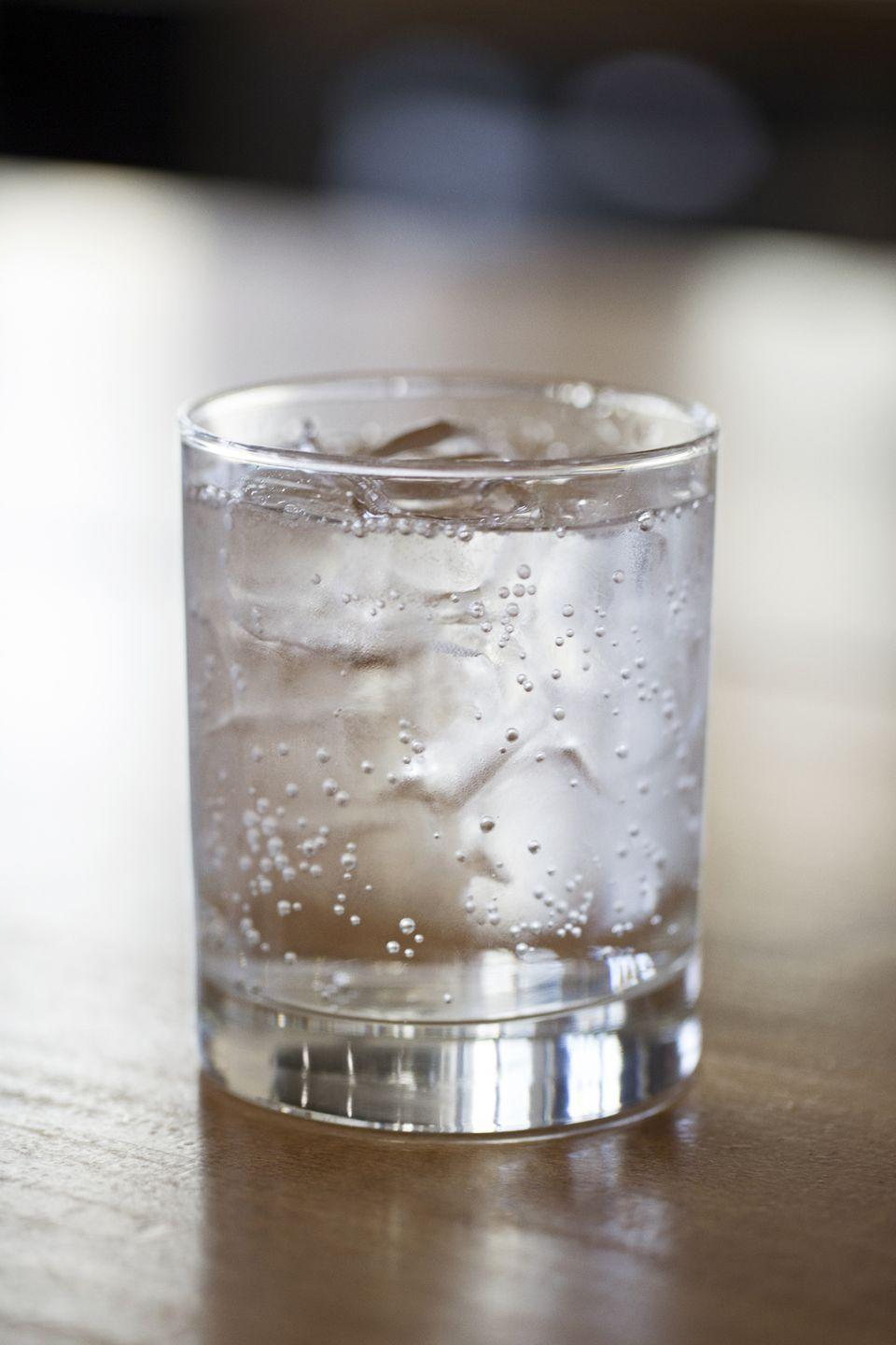 """<p>Subbing seltzer for tap water an easy way to add variety. Boehmer likes to add frozen fruit instead of ice for extra flavor. Pro tip: <a href=""""https://www.amazon.com/Perrier-Pineapple-Flavored-Carbonated-Mineral/dp/B085DWXVTY/ref=sr_1_5?crid=5N7YHRP74GCP&dchild=1&keywords=perrier+sparkling+water+pineapple&qid=1595879119&sprefix=perrier+sparkling+wateer+pineap%2Caps%2C146&sr=8-5"""" rel=""""nofollow noopener"""" target=""""_blank"""" data-ylk=""""slk:flavored seltzers"""" class=""""link rapid-noclick-resp"""">flavored seltzers </a>taste great alone and enhanced with extra fruit. Just don't down a six pack of sparkling water since that could<a href=""""https://www.menshealth.com/health/a19517635/carbonated-water/"""" rel=""""nofollow noopener"""" target=""""_blank"""" data-ylk=""""slk:damage enamel."""" class=""""link rapid-noclick-resp""""> damage enamel.</a> </p>"""